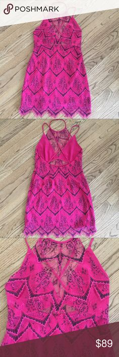 NWT Free people party pink lace dress sz 10 NWT Free people party pink lace with black detailing dress sz 10. So beautiful!! Perfect for wedding season or a special night out! Open criss cross back, scalloped lace bottom. Pink slip underneath covers chest and has a triangle opening on belly- this is all lace covered and really gives a very sexy look! This dress is so amazing!! Free People Dresses