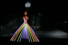 A model presents a creation by French fashion designer Frank Sorbier where patterns are being projected onto a white dress during the High Fashion Fall-Winter 2012-2013 collections in Paris, France, on July 4, 2012. UPI/Eco Clement