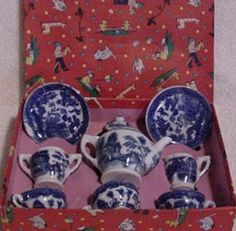 Sweet Blue Willow child's tea set.  I had this set as a child, all I have left is a plate and sugar bowl. I remember as a child thinking I'd be 57 when it would be antique. I'm there!