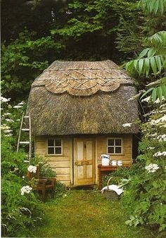 garden shed with a thatched roof