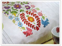 Love folk art embroidery!  Some funky embroidery on this site.  Cool!