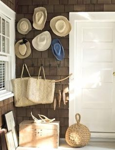 Hanging straw hats | Decorative and practical. Straw hats ready for grabs on the front ...