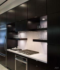 Dark wood flat panel cabinets give your kitchen an elevated and sophisticated contemporary look. Seen in The Studio in Houston.