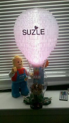 """Valentine's Day Getaway"" - Lego Hot Air Ballon with color changing mood light. Assembled by the 13 inch Lego plush."