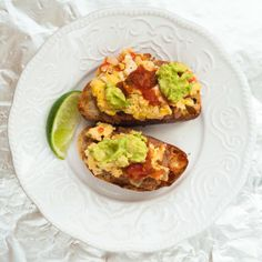 Crostini's with Scrambled eggs, Refried beans, and Guacamole.