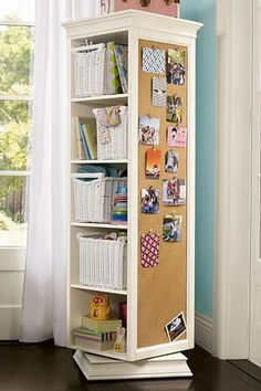 "This rotating bookcase from PB Teen looks like a great way to save space in a small bedroom. The unit offers shelves, a mirror, a corkboard, and peg hangers all in one unit that only occupies a 20.5"" square chunk of floorspace..."