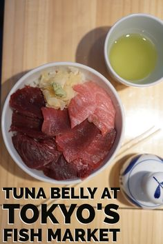 Best travel experiences in Japan-- visit the famous Tsukiji fish market in Tokyo and enjoy a sushi breakfast of fresh tuna belly.