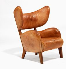 "850/1064 - Flemming Lassen: ""Flemming's Chair"". Large, unique, sculptural easy chair with Cuban mahogany frame. Upholstered with patinated natural leather."