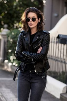 All black everything! Moto jacket with jeans and dark round glasses