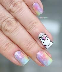 Unicorn accent nails.