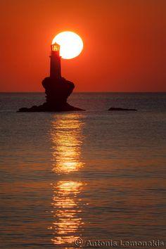 Sunrise at the lighthouse Tourlitis of Chora in Andros island, Cyclades, Greece Beautiful Sky, As You Like, Greece, Sunrise, Scenery, Around The Worlds, Orange Sky, Island, Lighthouses