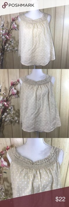 Sweet Wanderer Polka Dot Crotchet Top Shirt Large Absolutely adorable polka dot top with crochet lace yoke. Fits true to size with a loose comfortable fit. Perfect for your summer wardrobe to pair with jeans, slacks or shorts. Color-Tan/Cream with White polka dots Size-  Large Brand-Sweet Wanderer NWOT-New without tags (never worn) Self-100% Cotton Trim-80% Cotton 20% Polyester  Style# SJ3999 RN#104403 Sweet Wanderer Tops Blouses