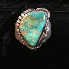 This huge signed Hallmarked Native American made Turquoise stone and Sterling Cuff Bracelet is magnificent! The varigation within the…