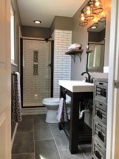 Contemporary Master Bath by BlankSpace LLC, Pittsburgh PA. Walk-in Shower with 2x8 Matte White Subway Tile and Shower Niche Hexagon Accent; Groutable Vinyl Floor Tile; Oil-Rubbed Bronze Accents