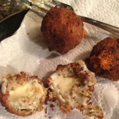 Kristi's Boudin Balls Stuffed with Cheesy Greatness O-M-G!  These are the best balls that you will ever put in your mouth! Fried with a kick of spice and a burst of oozing cheese.