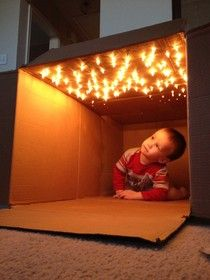 Awesome way to light a box fort. Would be better with no heat LED lights, less power, no risk of burning little fingers!