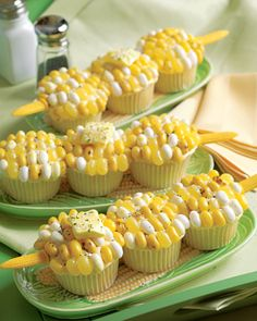 Corn on the Cob Cupcakes. Vanilla cupcakes with yellow frosting, yellow and white/cream Jelly belly's, yellow starburst (for the butter), and black and white sprinkles for the salt and pepper.