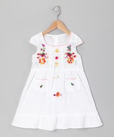With whimsical hand embroidery and an adorable fit, this dress is the perfect sunny day staple or a lively layer for grayer days. A crisscross lace-up front, sweetly stitched pockets and ruffle-trim hems are the little touches that make this breezy frock extra special.100% cottonMachine wash; tumble dryMa...