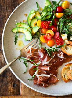 What a colorful plate of antipasti. Plus the avocado ties in our CA connection!