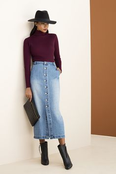 The very 70's inspired buttoned up denim maxi skirt, toped off with this season essential the poloneck. #ankleboot #miladysdenim #denim