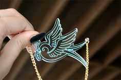 Traditional swallow tattoo necklace. https://www.etsy.com/listing/106286153/custom-traditional-tattoo-flash