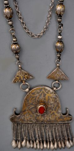 Unusual style necklace from Dzhezkazgen region in Kazakstan. Early 20th c Gilt silver design, granulation and carnelian. (inventory for sale info@singkiang.com)