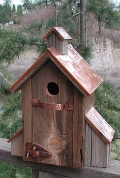 Classic rustic bird house i have a bag full of those latches. :)