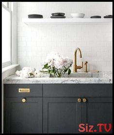 Dark Grey Kitchen Cabinets Dark Gray Kitchen Cabinets Accented With Aged Brass Knobs Vintage Brass Inset Pulls And A Honed Gray And White Marble Completed With A Marble Dark Grey Kitchen Cabinets, Grey Kitchens, Painting Kitchen Cabinets, Kitchen Countertops, Cool Kitchens, Kitchen Backsplash, White Cabinets, Subway Backsplash, Subway Tiles