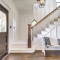 A stately staircase with board and batten wood siding. A stately staircase with board and batten wood siding. Staircase Makeover, Stair Walls, Staircase Design, Staircase With Landing, Staircase Ideas, Wood Siding, Entry Foyer, Entryway Stairs, Home Reno