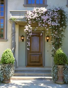 Something very simple and also very beautiful you can do for your front door entrance is to have flower pots. Display them on either side of the door or in its vicinity. If you have a covered porch then it's even better because you get to beautifully display numerous flower pots and they will be protected from ..