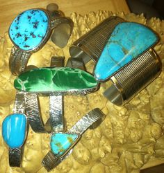 Multiple turquoise cuff bracelets designed by Felicita Designs and made by Colorado Jewelrydude