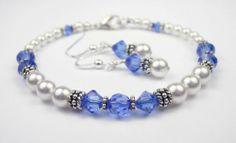 Damali .925 Sterling Silver Crystal Bracelet in September Sapphire Swarovski Crystal Birthstones - MEDIUM 7 1/4 In. Damali. $89.95