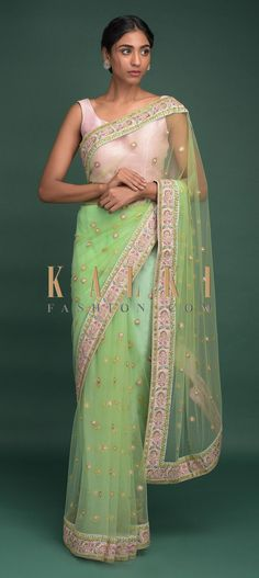 Buy Online from the link below. We ship worldwide (Free Shipping over US$100)  Click Anywhere to Tag Pista Green Saree In Net With Resham, Sequins And Zari Embroidered Floral Buttis Online - Kalki Fashion Pista green saree in net enhanced with resham, sequins and zari embroidered floral buttis.It comes with a blush pink border with embroidered floral pattern.