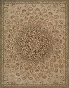 Nourison 2000. You'll never tire of meditating on the beauty of this dramatic design taken from ancient Persian mandalas. Like a sun radiating light, it emits swirls of traditional palmette shapes in a detail-dense pattern that gains complexity towards the center. The multicolor palette has antiqued greens and garnets predominant with central ivory accents that sparkle like pearls.