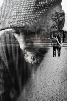 Double exposure of a very sad man who recalls his younger age by Beatrix Boros