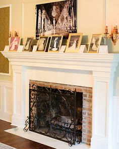 The fireplace in the living room at Black Iris Estate in Carmel Indiana. The clients for this event brought family photos to decorate the mantel