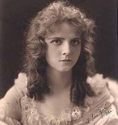 Olive Thomas (1894-1920). American silent film actress. Began her career as a model in 1914, and moved on to the Ziegfeld Follies in 1915. In 1916, she began a successful career in silent movies and appeared in over 20 films in 4 years. She married the younger brother of silent film star Mary Pickford. In 1920, she died of acute nephritis five days after consuming mercury bichloride. Her death was ruled accidental, but the incident became one of Hollywood's biggest scandals.