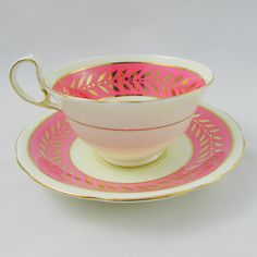 Beautiful Aynsley tea cup is pink with a gold leaf border. Gold trimming on cup and saucer edges, and on handle. Excellent condition (see photos). Markings read: Bone China Aynsley England For more Aynsley tea cups, please click here: