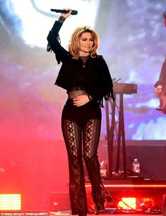 Sexy stuff: Shania's honey blonde locks were styled into a stunning bouncy do which only added to the hyper glamorous feel of the entire ensemble