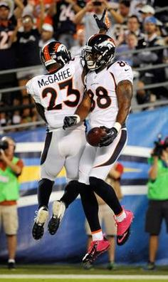 Denver Broncos wide receiver Demaryius Thomas (88) celebrates his touchdown with running back Willis McGahee (23)