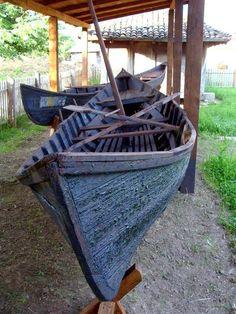 danube-delta-black-sea. Dobrogea traditional fishing boat. Danube delta lotca. Wine museum Golesti. Romania