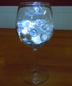 Wine glass lights; make them with any color stones.