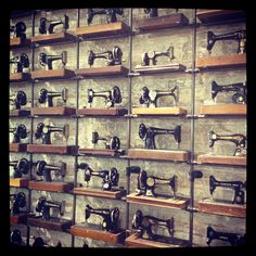 A wall of antique Singer sewing machines inside AllSaints Spitalfields on 5th Ave in Seattle, WA