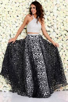 Prom Dresses Evening Dresses by SHAIL K.<BR>ash40712<BR>Two piece halter gown embellished with beads and stones on crop top to sheer overlay floor length skirt.