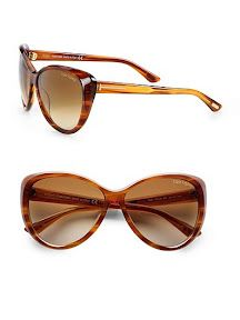 A chic, acetate design with a beveled rim and logo temples. Available in shiny striped brown with brown gradient lens.