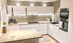 Kitchen - I like the counter layout, the floating shelves along the back wall w the lighting accents & oven in the wall