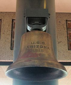 One of the several bells of the USS Arizona in the former Visitor Center of the USS Arizona Memorial, Pearl Harbor, Hawaii.