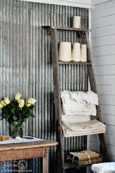 An old ladder used as a shelf in a Cottage Style Guest Room! via knickoftime.net