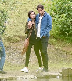 Leaning on him: The pair strolled together hand in hand through the lush green countryside and even decided to get an ice cream together, despite the rainy conditions