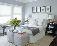 Stools eat end of bed instead of bench? Elle Decor - Monelle Totah - white & purple bedroom design with slip-covered white . Small Guest Rooms, Guest Bedrooms, Blue Bedrooms, Master Bedrooms, White Upholstered Headboard, Slipcovered Headboard, Slipcovers, Blue Gray Bedroom, White Bedroom